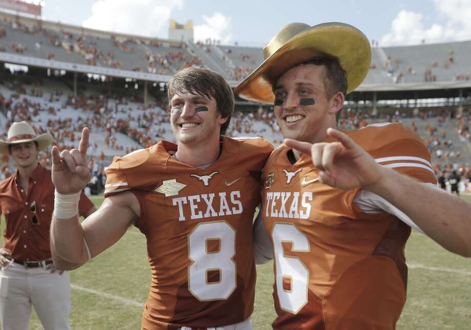Texas quarterback Case McCoy (6) and teammate wide receiver Jaxon Shipley (8) pose for photos with the Golden Hat trophy. Photo: Brandon Wade, Associated Press