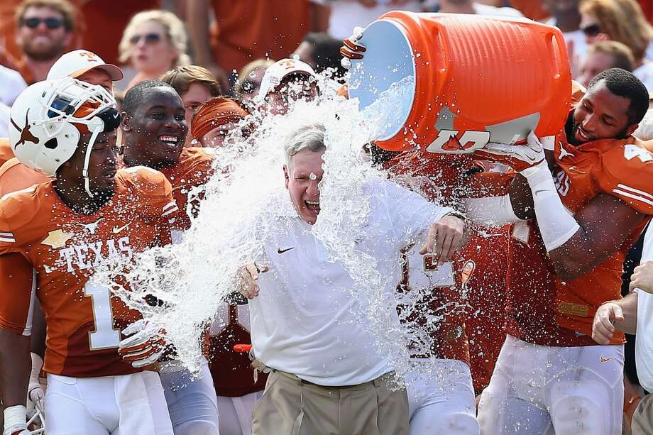 Mack Brown has a cooler of ice water dumped on him by his team after the win. Photo: Tom Pennington, Getty Images