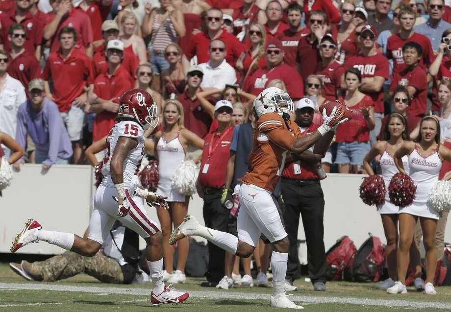 Texas wide receiver Mike Davis (1) catches a touchdown pass while being defended by Oklahoma's Zack Sanchez (15) during the second half. Photo: Brandon Wade, Associated Press
