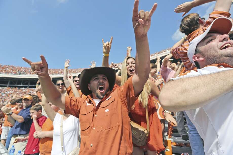 Texas fans cheer after a score during the second half Photo: LM Otero, Associated Press
