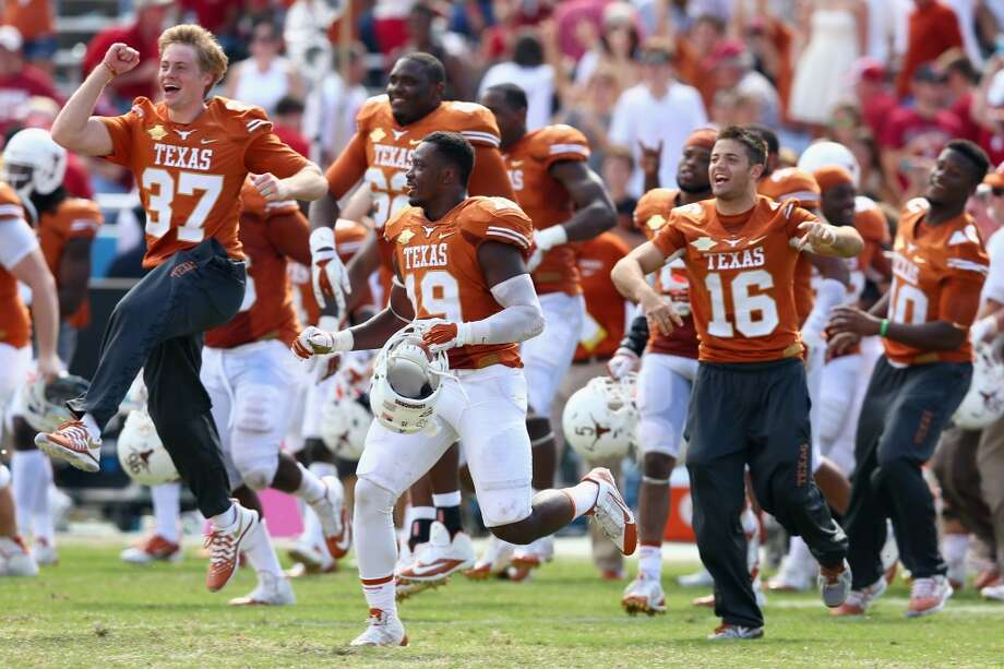The Longhorns celebrate after the win. Photo: Tom Pennington, Getty Images
