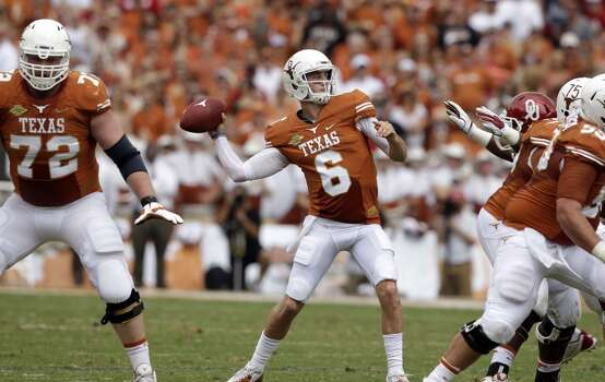 Texas quarterback Case McCoy (6) passes during the first half. Photo: LM Otero, Associated Press
