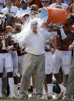 Texas head coach Mack Brown gets dunked by his players after the win. Photo: LM Otero, Associated Press