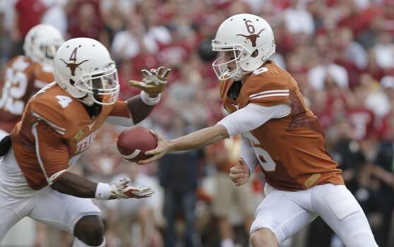 Texas quarterback Case McCoy (6) hands off to Texas running back Daje Johnson (4) during the first half. Photo: Brandon Wade, Associated Press