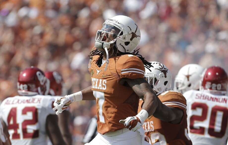 Texas wide receiver Marcus Johnson (7) yells as he celebrates catching a touchdown pass during the first half. Photo: Brandon Wade, Associated Press