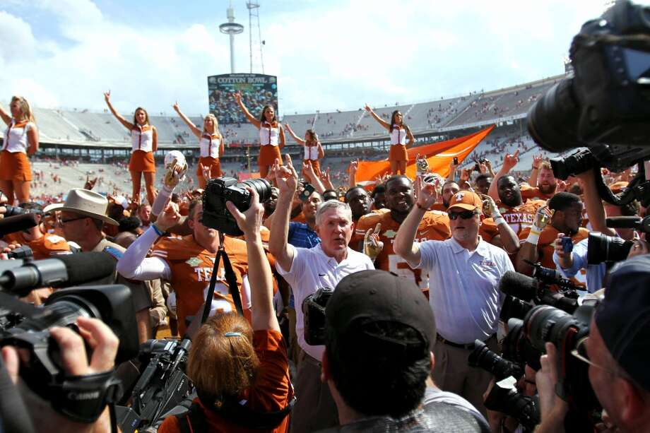 "Mack Brown sings ""The Eyes of Texas"" with his team after the win. Photo: Chelsea Purgahn, Associated Press"
