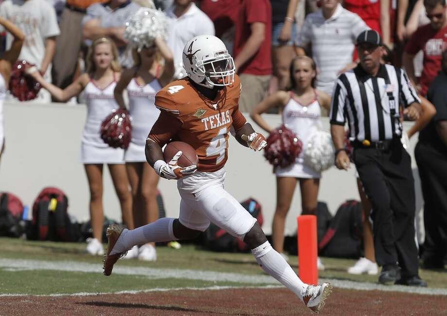 Daje Johnson scores a touchdown on a punt return during the third quarter. Photo: Brandon Wade, Associated Press