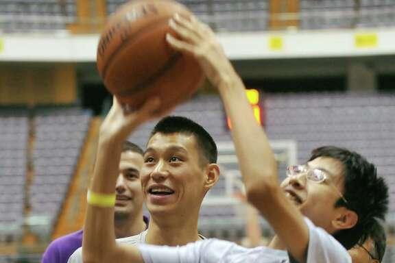 Rockets point guard Jeremy Lin, left, assumes the role of coach as he and his teammates instruct students during the NBA Cares Special Olympics Clinic on Saturday in Taipei, Taiwan.