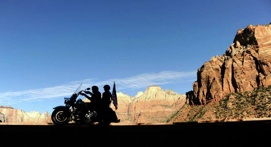 Motorcyclists ride through the now-opened Zion National Park, welcome news for beleaguered shop owners in Springdale, Utah, adjacent to the park. Photo: David Becker / Getty Images