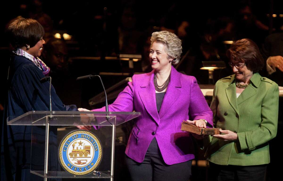 U.S. District Judge Vanessa Gilmore, left, swears in Annise Parker, center, for her second term as mayor in 2012. She is running for a third and final term.