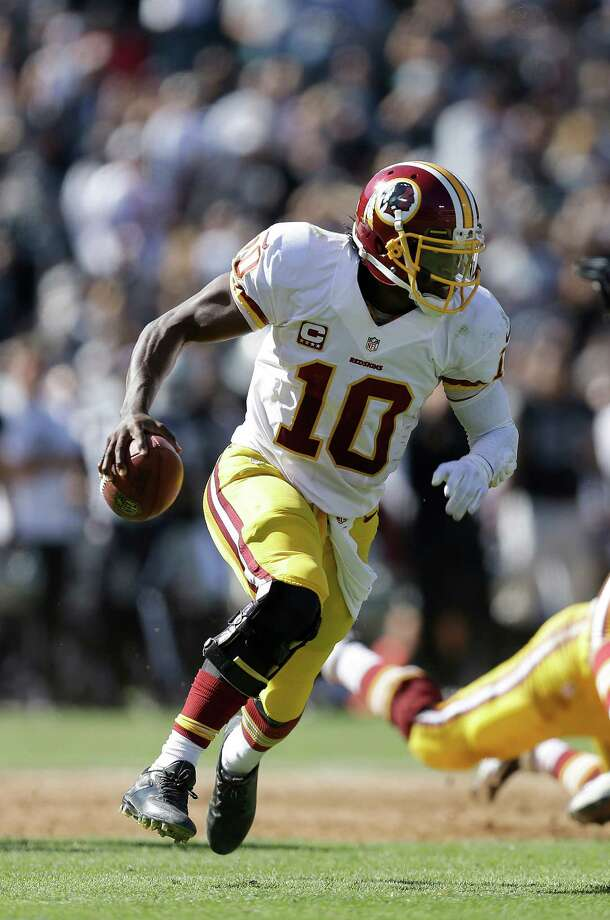 Washington Redskins quarterback Robert Griffin III (10) against the Oakland Raiders during an NFL football game in Oakland, Calif., Sunday, Sept. 29, 2013. (AP Photo/Ben Margot) Photo: Ben Margot, Associated Press / AP