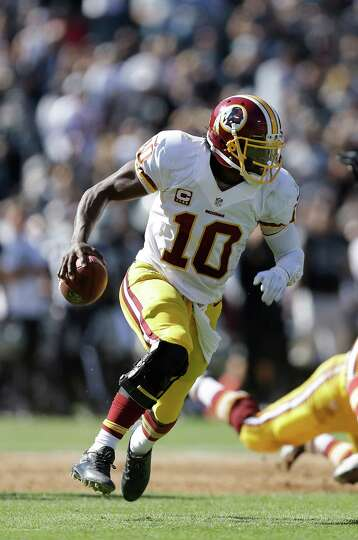 Washington Redskins quarterback Robert Griffin III (10) against the Oakland Raiders during an NFL fo