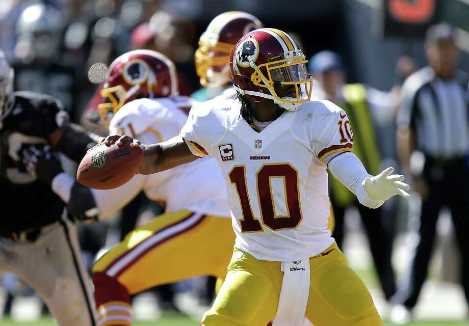 Washington Redskins quarterback Robert Griffin III (10) against the Oakland Raiders during the first half of an NFL football game in Oakland, Calif., Sunday, Sept. 29, 2013. (AP Photo/Ben Margot) Photo: Ben Margot, Associated Press / AP