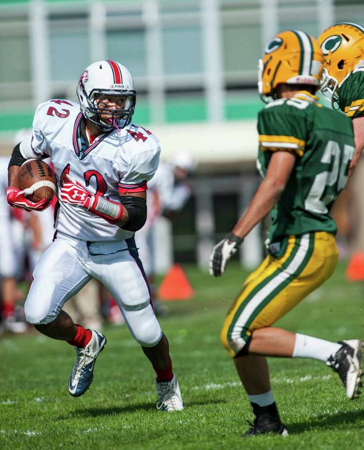 Foran high school running back Andrew Khon picks up some yardage during a football game against Trinity Catholic high school played at Trinity in Stamford, CT on Saturday, October, 12th, 2013 Photo: Mark Conrad / Stamford Advocate Freelance