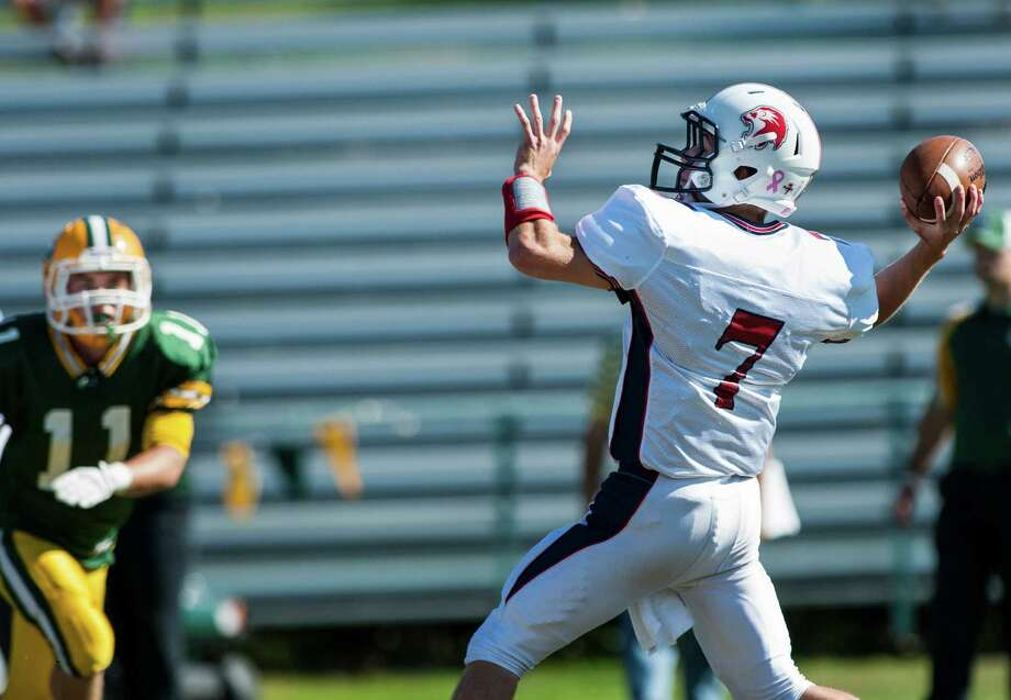 Foran high school quarterback Jake Kasuba throws downfield to a receiver during a football game against Trinity Catholic high school played at Trinity in Stamford, CT on Saturday, October, 12th, 2013 Photo: Mark Conrad / Stamford Advocate Freelance