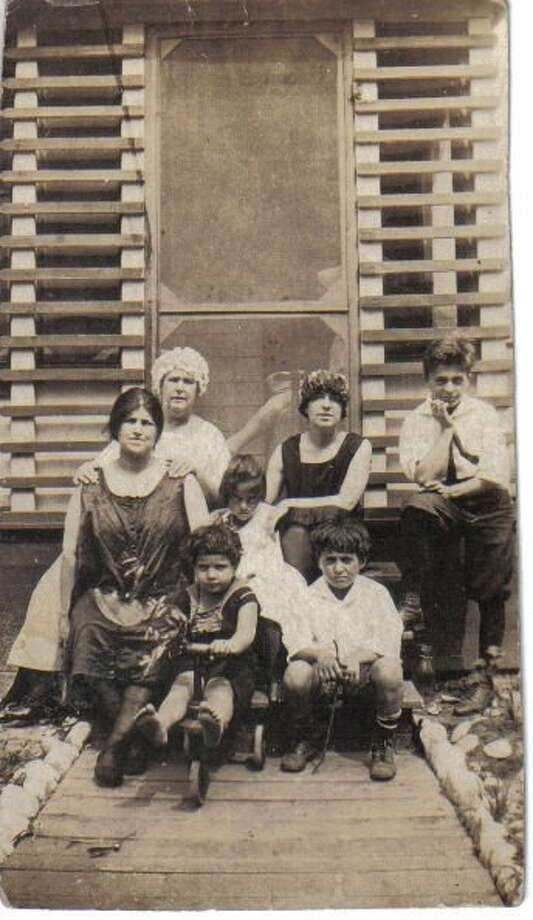 Luigi Leopoldo Bianculli as a kid, far right, with family members
