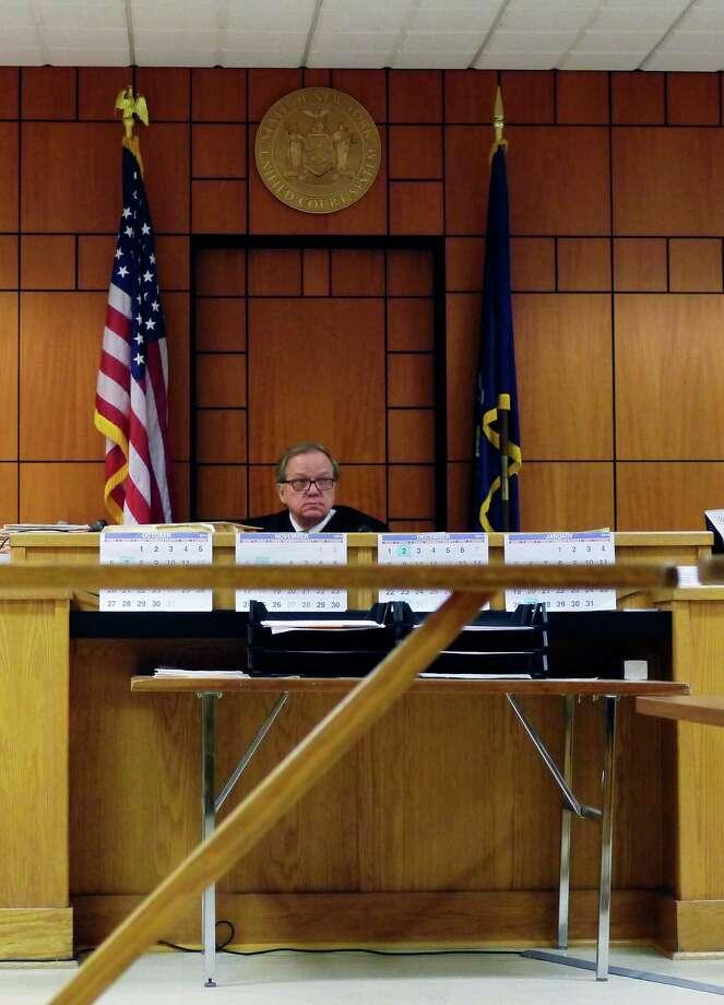 Albany City Court Judge Thomas Keefe talks to lawyers and defendants during court on Thursday, Oct. 10, 2013 in Albany, NY.   (Paul Buckowski / Times Union) Photo: Paul Buckowski / 00024212A