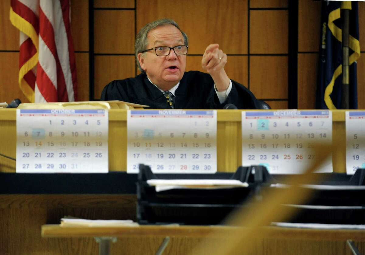 Albany City Court Judge Thomas Keefe talks to lawyers and defendants during court on Thursday, Oct. 10, 2013 in Albany, NY. (Paul Buckowski / Times Union)
