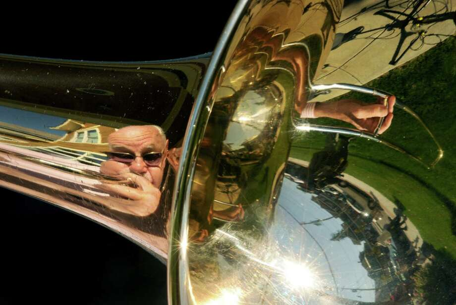 Trombonist Woody Strobeck is seen in the reflection of his trombone bell as he performs with Skip Parson's Clarinet Marmalade during the upper Union Street SchenectadyOs 8 th Annual Harvest Fest & Art Show on Saturday Oct. 12, 2013 in Schenectady, N.Y. (Michael P. Farrell/Times Union) Photo: Michael P. Farrell / 00023965A