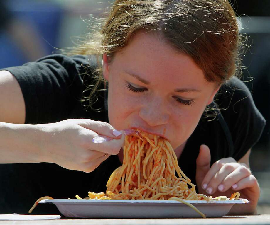 Geena Bocci eats a plate of pasta during the Pasta Eating Contest at the 35th Houston Italian Festival at the University of St. Thomas Saturday, Oct. 12, 2013, in Houston. Photo: James Nielsen, Houston Chronicle / © 2013  Houston Chronicle