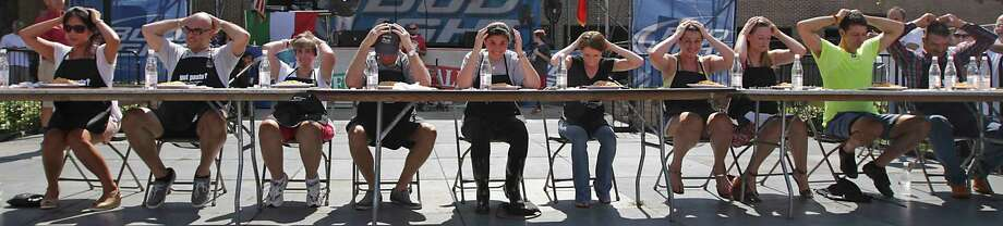 Contestants prepare for the start of the Pasta Eating Contest during the 35th Houston Italian Festival at the University of St. Thomas Saturday, Oct. 12, 2013, in Houston. Photo: James Nielsen, Houston Chronicle / © 2013  Houston Chronicle