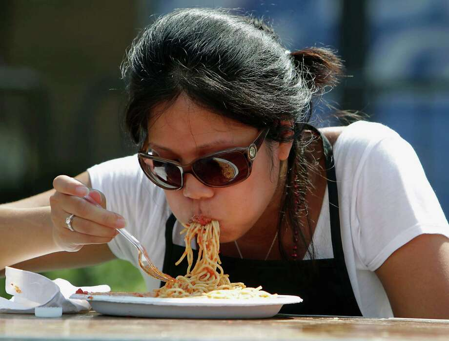 Imelda Suerte eats a plate of pasta during the Pasta Eating Contest at the 35th Houston Italian Festival at the University of St. Thomas Saturday, Oct. 12, 2013, in Houston. Photo: James Nielsen, Houston Chronicle / © 2013  Houston Chronicle