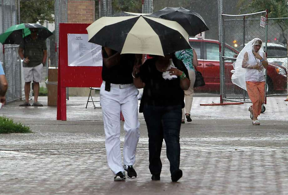 A rain shower during the 35th Houston Italian Festival at the University of St. Thomas Saturday, Oct. 12, 2013, in Houston. Photo: James Nielsen, Houston Chronicle / © 2013  Houston Chronicle