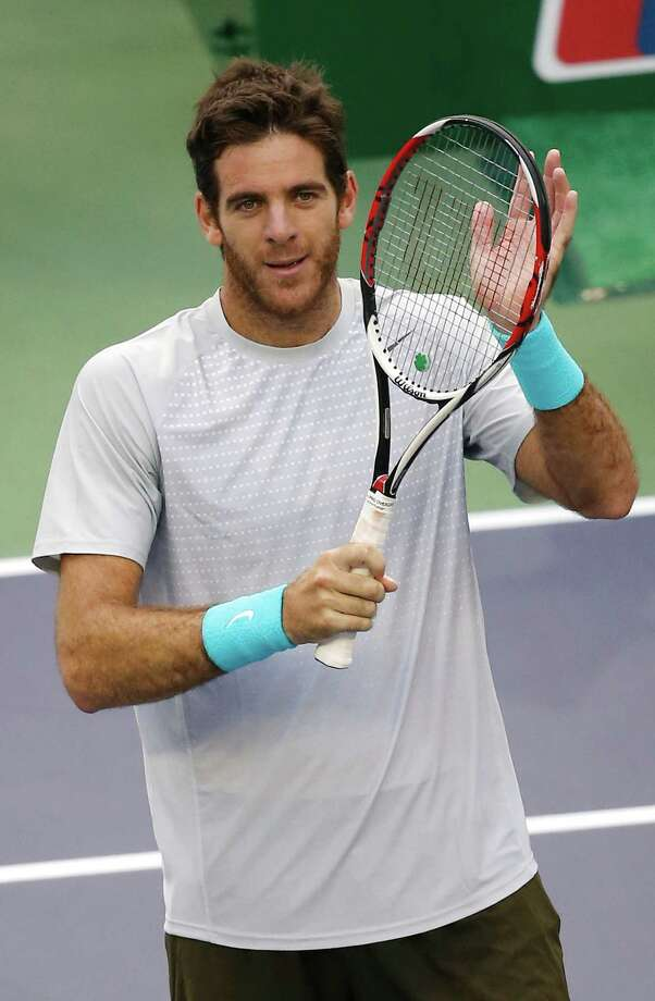 Juan Martin del Potro of Argentina greets the spectators after defeating Nicolas Almagro of Spain during the singles quarterfinal match of the Shanghai Masters tennis tournament at Qizhong Forest Sports City Tennis Center, in Shanghai, China, Friday, Oct. 11, 2013. Del Potro won 6-3, 6-3. (AP Photo/Eugene Hoshiko) ORG XMIT: XEH112 Photo: Eugene Hoshiko / AP