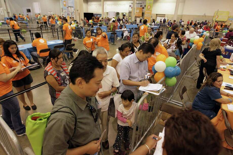A line for flu shots at the Be Covered Houston Care Fair. Photo: James Nielsen, Houston Chronicle / © 2013  Houston Chronicle