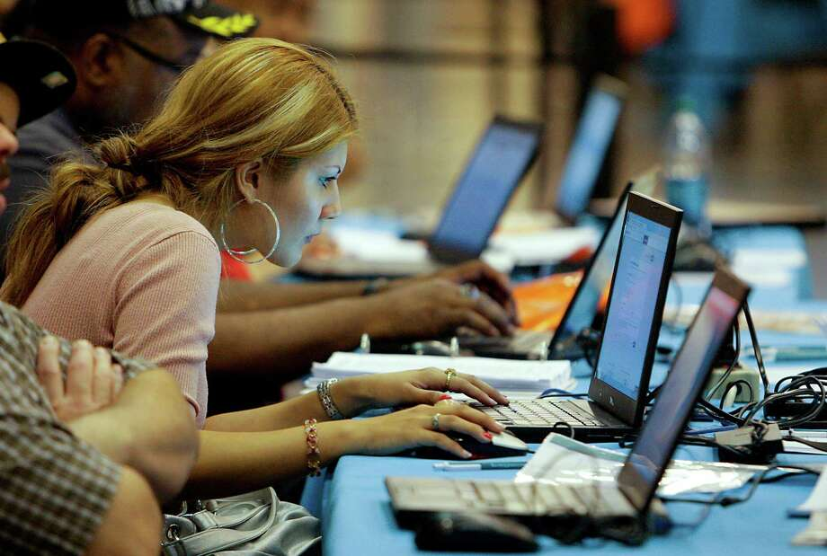 Antonia Alejandre uses a computer at health insurance assistance section at the Be Covered Houston Care Fair, which is part of Be Covered Texas, a statewide education and outreach campaign sponsored by Blue Cross and Blue Shield of Texas at the Reliant Center Saturday, Oct. 12, 2013, in Houston. Photo: James Nielsen, Houston Chronicle / © 2013  Houston Chronicle