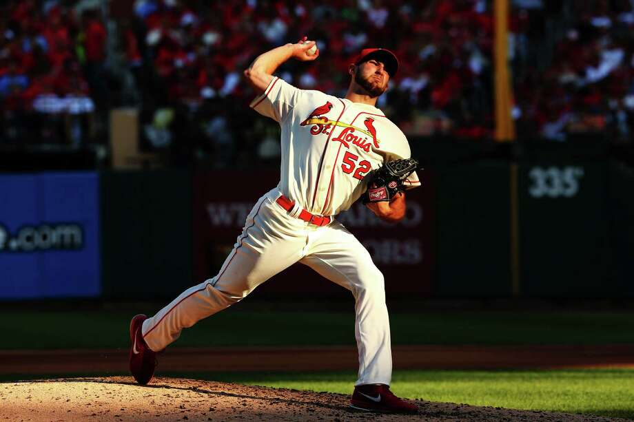 ST LOUIS, MO - OCTOBER 12:  Michael Wacha #52 of the St. Louis Cardinals pitches against the Los Angeles Dodgers during Game Two of the National League Championship Series at Busch Stadium on October 12, 2013 in St Louis, Missouri.  (Photo by Elsa/Getty Images) ORG XMIT: 184309290 Photo: Elsa / 2013 Getty Images