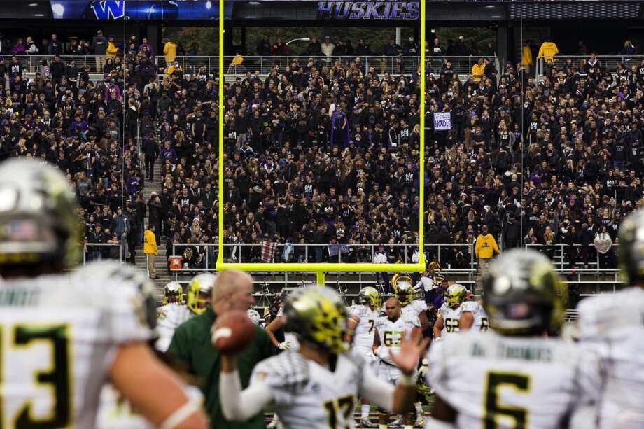 Oregon Ducks warm up before a game against the Washington Huskies Saturday, Oct. 12, 2013, at Husky Stadium in Seattle. Ducks led the Huskies 21-7 at the half. The Oregon Ducks stand at 5-0 against the Washington Huskies, 4-1, so far in the season to date. (Jordan Stead, seattlepi.com) Photo: JORDAN STEAD, SEATTLEPI.COM