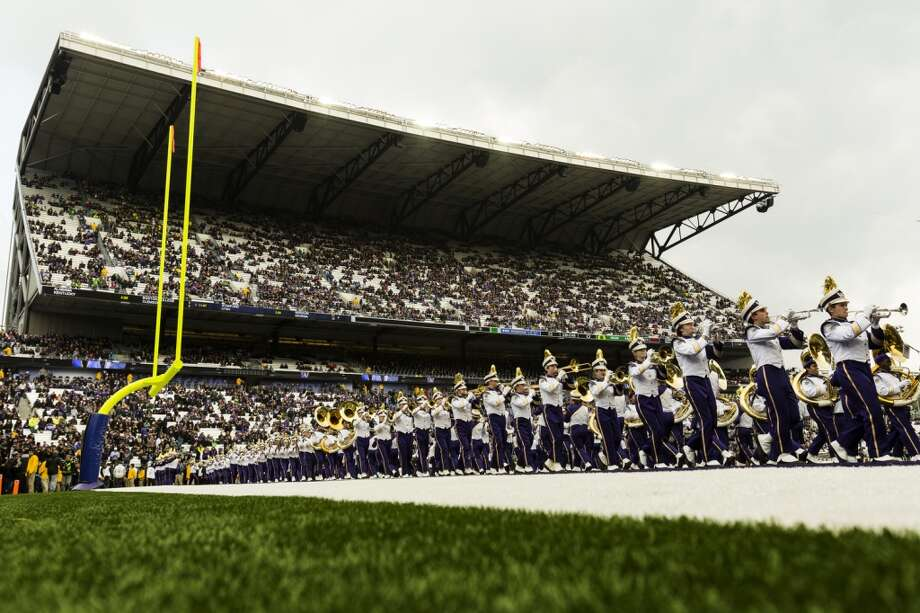 Members of the Husky Band perform before a game against the Oregon Ducks Saturday, Oct. 12, 2013, at Husky Stadium in Seattle. Ducks led the Huskies 21-7 at the half. The Oregon Ducks stand at 5-0 against the Washington Huskies, 4-1, so far in the season to date. (Jordan Stead, seattlepi.com) Photo: JORDAN STEAD, SEATTLEPI.COM