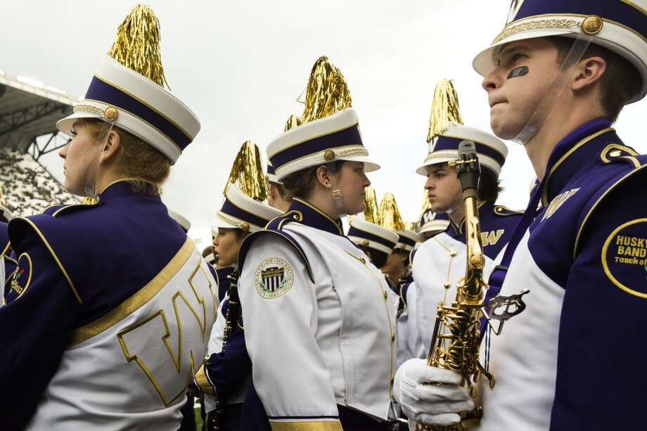 Members of the Husky Band await their turn to perform before a game against the Oregon Ducks Saturday, Oct. 12, 2013, at Husky Stadium in Seattle. Ducks led the Huskies 21-7 at the half. The Oregon Ducks stand at 5-0 against the Washington Huskies, 4-1, so far in the season to date. (Jordan Stead, seattlepi.com) Photo: JORDAN STEAD, SEATTLEPI.COM