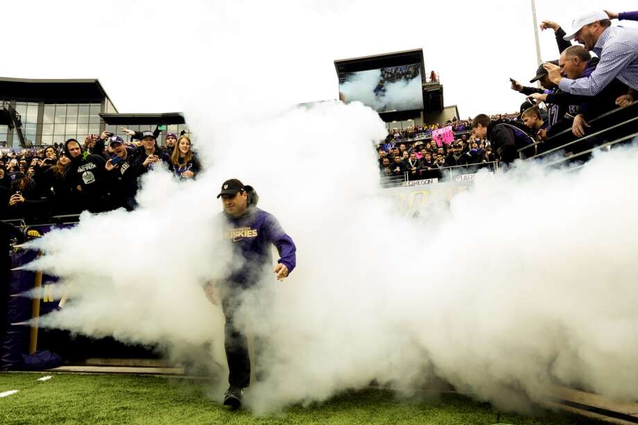 UW head coach Steve Sarkisian runs onto the field before a game against the Oregon Ducks Saturday, Oct. 12, 2013, at Husky Stadium in Seattle. Ducks led the Huskies 21-7 at the half. The Oregon Ducks stand at 5-0 against the Washington Huskies, 4-1, so far in the season to date. (Jordan Stead, seattlepi.com) Photo: JORDAN STEAD, SEATTLEPI.COM