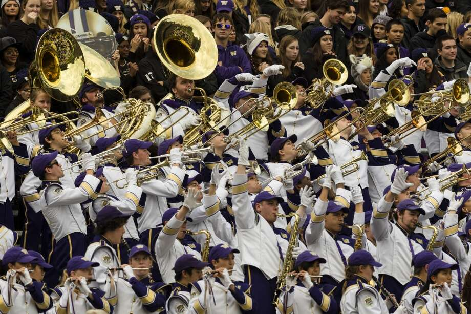 Fans and band line the stand for a sold-out game against the Oregon Ducks Saturday, Oct. 12, 2013, at Husky Stadium in Seattle. Ducks led the Huskies 21-7 at the half. The Oregon Ducks stand at 5-0 against the Washington Huskies, 4-1, so far in the season to date. (Jordan Stead, seattlepi.com) Photo: JORDAN STEAD, SEATTLEPI.COM