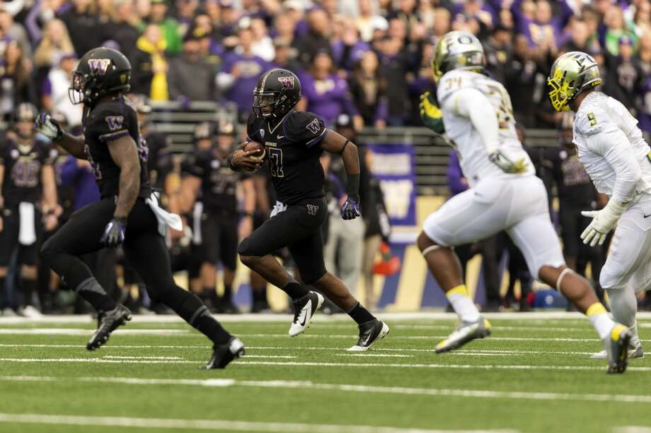 UW's Trevor Walker, center, sprints downfield during the first half of a game Saturday, Oct. 12, 2013, at Husky Stadium in Seattle. Ducks led the Huskies 21-7 at the half. The Oregon Ducks stand at 5-0 against the Washington Huskies, 4-1, so far in the season to date. (Jordan Stead, seattlepi.com) Photo: JORDAN STEAD, SEATTLEPI.COM
