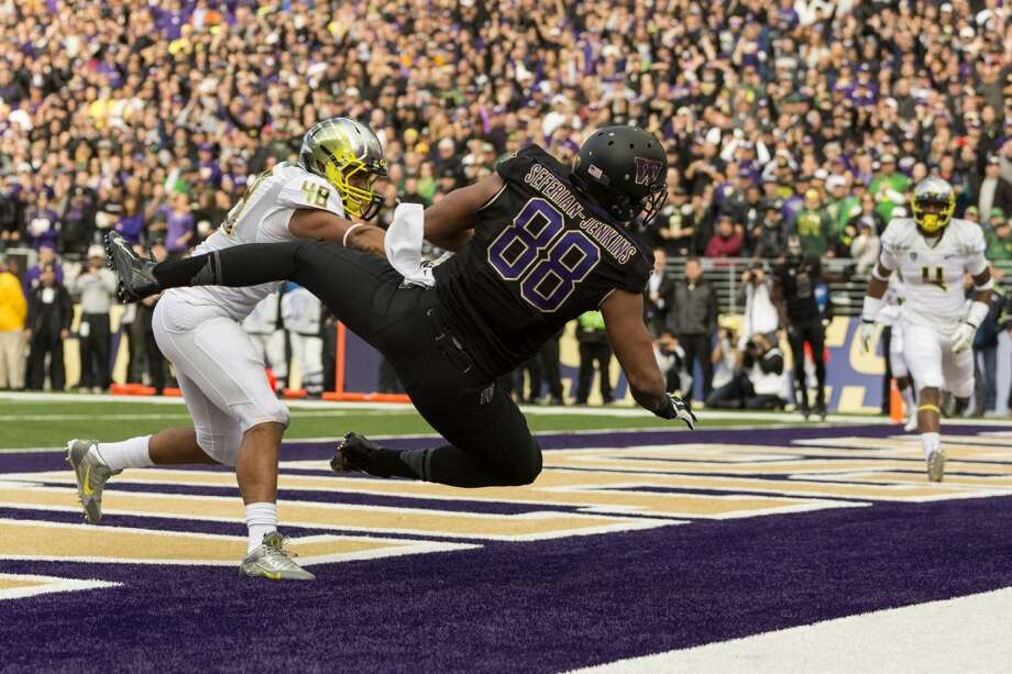 UW's Austin Seferian-Jenkins flies into the end zone to make a touchdown against the Oregon Ducks during the first half of a game Saturday, Oct. 12, 2013, at Husky Stadium in Seattle. Ducks led the Huskies 21-7 at the half. The Oregon Ducks stand at 5-0 against the Washington Huskies, 4-1, so far in the season to date. (Jordan Stead, seattlepi.com) Photo: JORDAN STEAD, SEATTLEPI.COM