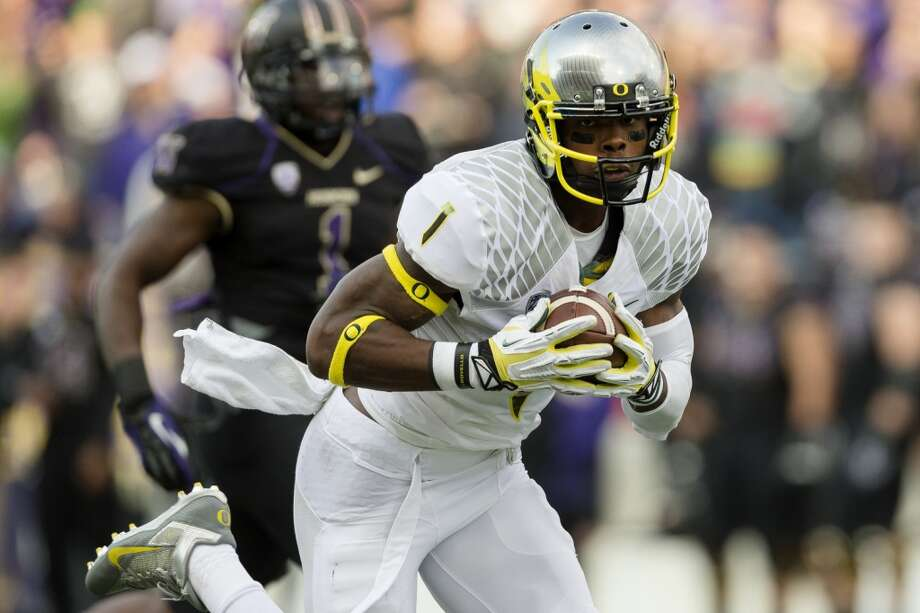 Oregon's Josh Huff makes a run after an interception during the second half of a game Saturday, Oct. 12, 2013, at Husky Stadium in Seattle. The interception was later recalled. The Ducks beat the Huskies 45-24. (Jordan Stead, seattlepi.com) Photo: JORDAN STEAD, SEATTLEPI.COM