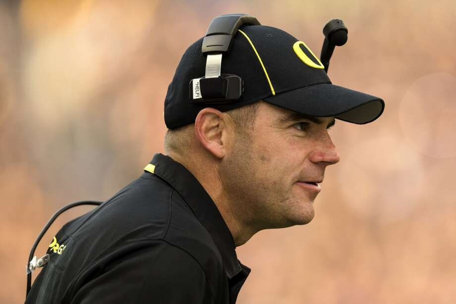 Oregon's head coach Mark Helfrich watches his team play against the UW Huskies during the second half of a game Saturday, Oct. 12, 2013, at Husky Stadium in Seattle. The Ducks beat the Huskies 45-24. (Jordan Stead, seattlepi.com) Photo: JORDAN STEAD, SEATTLEPI.COM