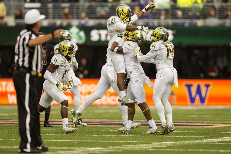 Oregon Ducks rejoice after a touchdown against the Huskies during the first half of a game Saturday, Oct. 12, 2013, at Husky Stadium in Seattle. Ducks led the Huskies 21-7 at the half. The Oregon Ducks stand at 5-0 against the Washington Huskies, 4-1, so far in the season to date. (Jordan Stead, seattlepi.com) Photo: JORDAN STEAD, SEATTLEPI.COM