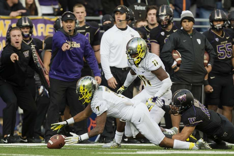 Players scramble for a fumble during the second half of a game Saturday, Oct. 12, 2013, at Husky Stadium in Seattle. The Ducks beat the Huskies 45-24. (Jordan Stead, seattlepi.com) Photo: JORDAN STEAD, SEATTLEPI.COM