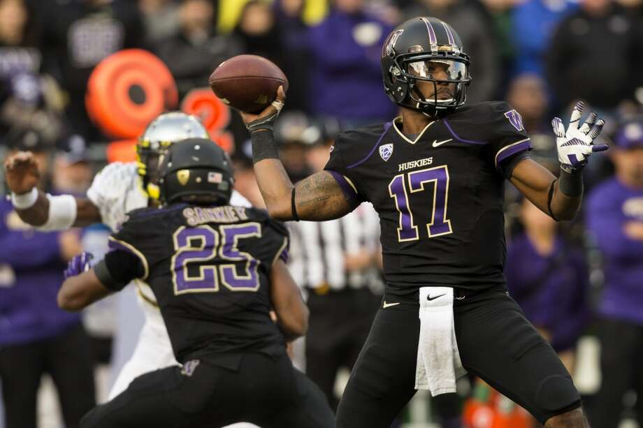 Husky quarterback Keith Price, cocks back to throw to a teammate during the second half of a game Saturday, Oct. 12, 2013, at Husky Stadium in Seattle. The Ducks beat the Huskies 45-24. (Jordan Stead, seattlepi.com) Photo: JORDAN STEAD, SEATTLEPI.COM