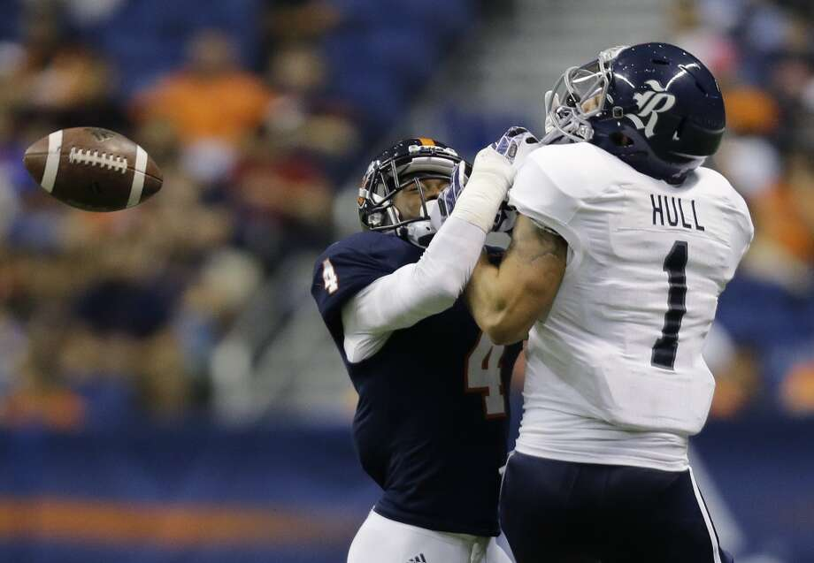 UTSA defender Crosby Adams III (4) breaks up a pass intended for Rice's Mario Hull (1) during the second half of an NCAA college football game on Saturday, Oct. 12, 2013, in San Antonio. Rice won 27-21. (AP Photo/Eric Gay) Photo: Eric Gay, Associated Press