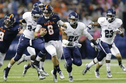 UTSA's Eric Soza (8) scrambles for a first down as Rice defenders Paul Porras (24), Malcolm Hill (20) and Anthony Canady (23) pursue during the first half of an NCAA college football game on Saturday, Oct. 12, 2013, in San Antonio. (AP Photo/Eric Gay) Photo: Eric Gay, Associated Press