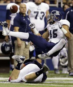 Rice's Phillip Gaines (15) breaks up a pass intended for UTSA's Cole Hubble, bottom, during the second half of an NCAA college football game on Saturday, Oct. 12, 2013, in San Antonio. Rice won 27-21. (AP Photo/Eric Gay) Photo: Eric Gay, Associated Press