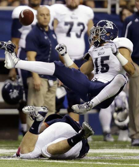 Rice's Phillip Gaines (15) breaks up a pass intended for UTSA's Cole Hubble, bottom, during the seco