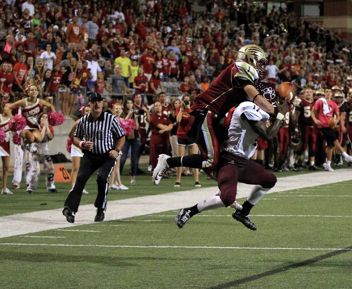 Cy-Fair's Justin Burrell (17) breaks up a pass intended for Cy-Woods' Mason Roberts during the second half of a high school football game, Saturday, October 12, 2013 at Berry Center in Cypress.