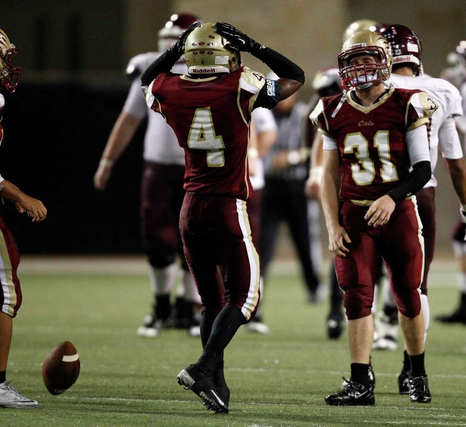 Cy-Woods' Wade Carson (31) and Stevie Polly react after Carson dropped a interception during the second half of a high school football game against Cy-Fair, Saturday, October 12, 2013 at Berry Center in Cypress. Photo: Eric Christian Smith, For The Chronicle