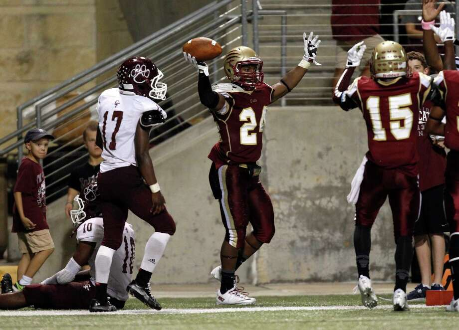 Cy-Woods' Samuel Stewart (24) celebrates his touchdown as Cy-Fair's Justin Burrell (17) looks on during the second half of a high school football game, Saturday, October 12, 2013 at Berry Center in Cypress. Photo: Eric Christian Smith, For The Chronicle
